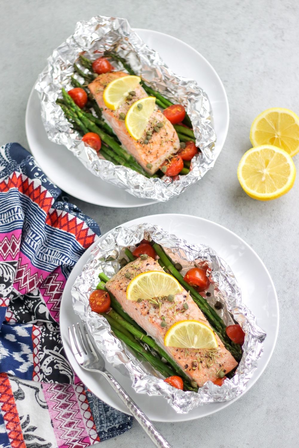 Grilled fish in foil with vegetables