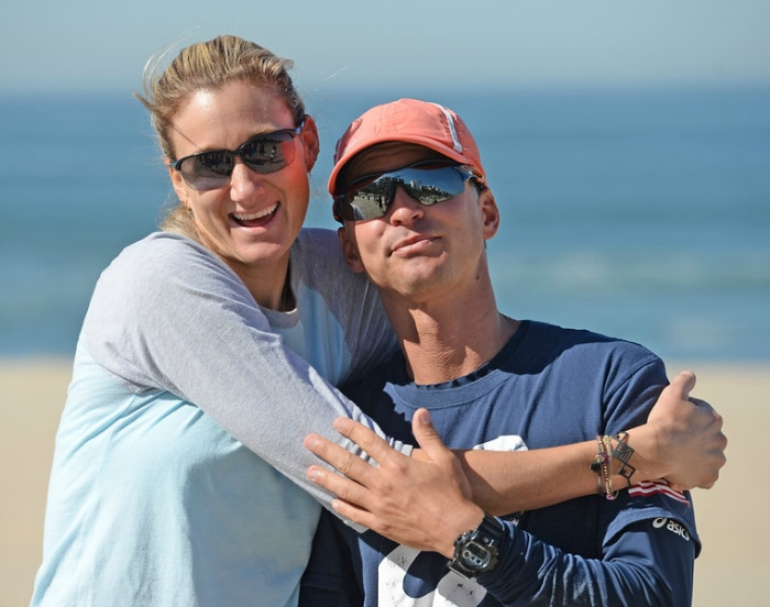 Volleyball player Kerri Walsh Jennings works-out on the beach as she prepares for the Rio Olympic Games this summer. Walsh Jennings looks to add her fourth gold medal. Kerri hugs her coach Marcio Sicoli after a morning training session. Wednesday, March 23, 2016, Manhattan Beach, CA. Photo by Steve McCrank/Staff Photographer